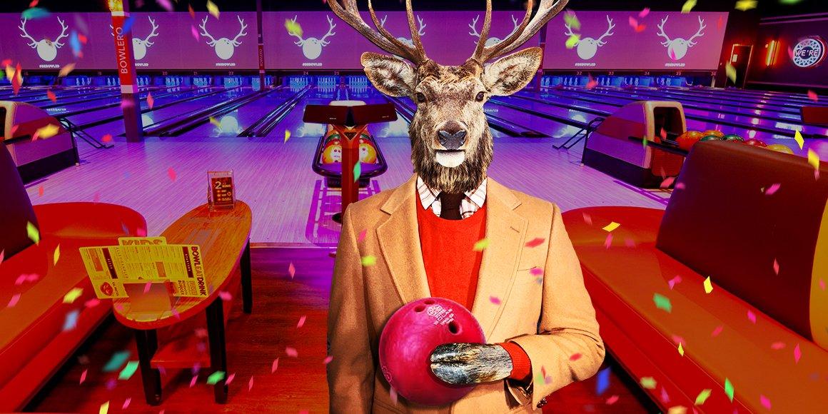 deer holding a bowling ball