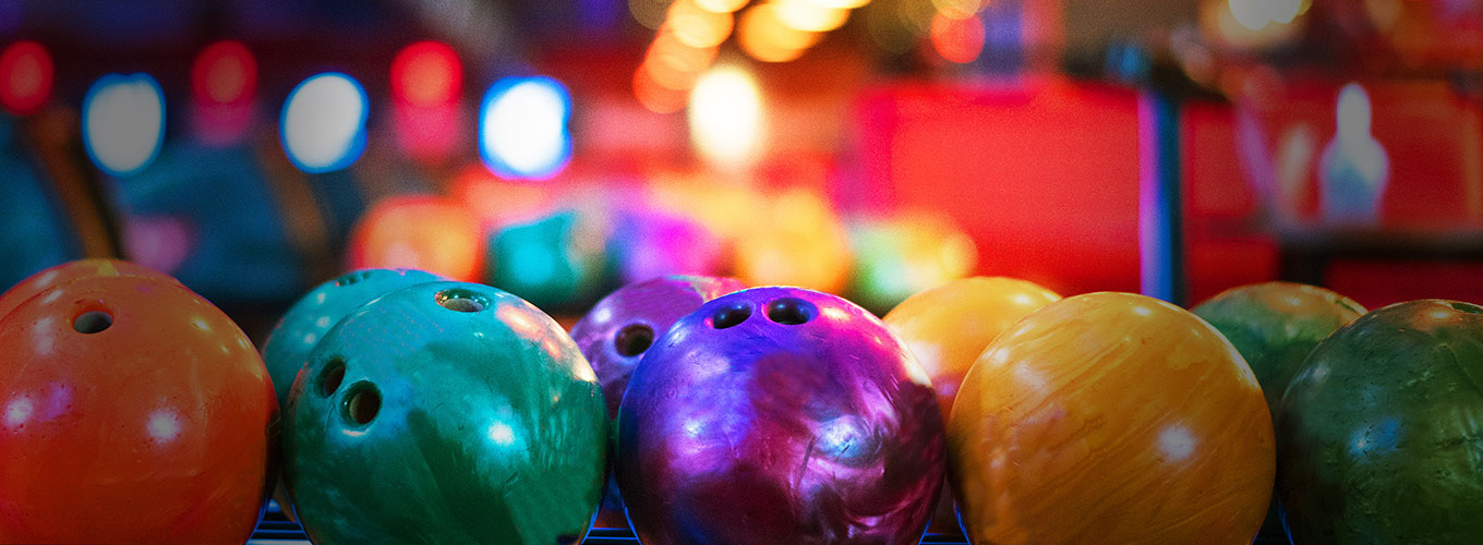 a rack of colorful bowling balls