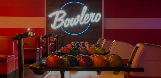 Ball returns with the Bowlero logo glowing in the background
