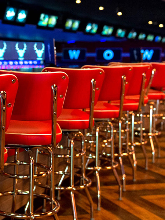 Red barstools and lanes