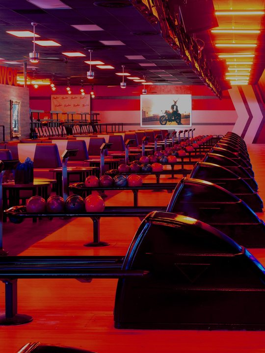 view of ball returns and seating lit red