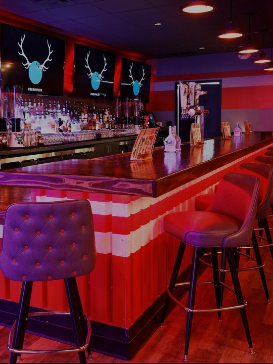 view of bar lit red