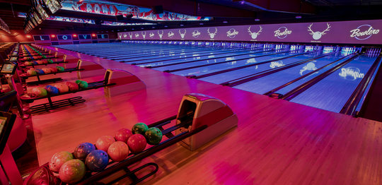 Ball returns and bowling lanes with 'LOVE' written on the wall