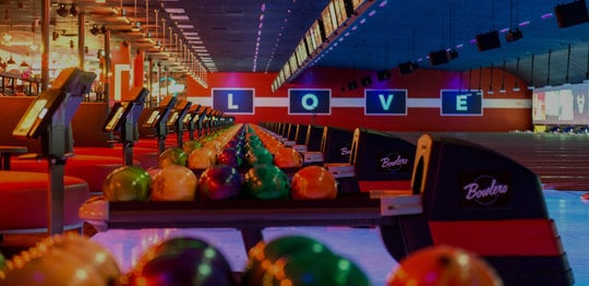 Ball returns with bowling balls and 'LOVE' written out on the wall