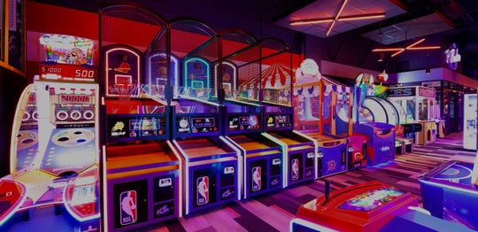 Arcade games with neon lighting