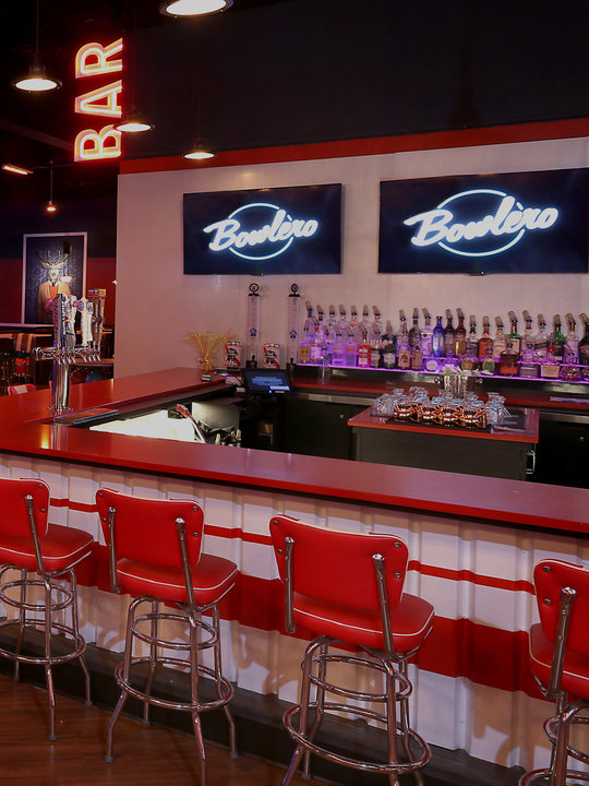 Retro bar area with red stools