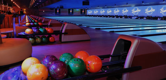 Ball return with bowling balls looking out to the lanes