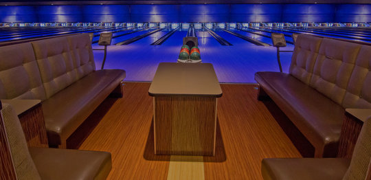 Front view of bowling lanes with plush couches