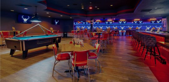 bar area with high tops and billiards table