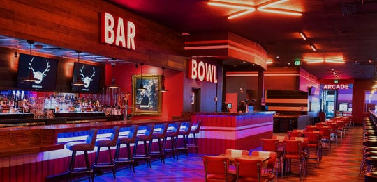 Dining area and bar at Bowlero Timonium