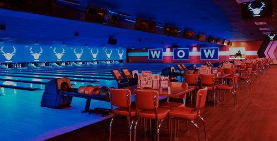 view of lanes lit blue and seating