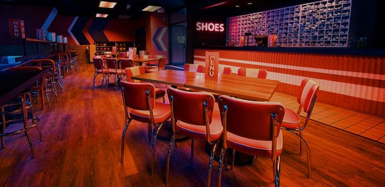 Dining area and shoe desk at Bowlero Wauwatosa