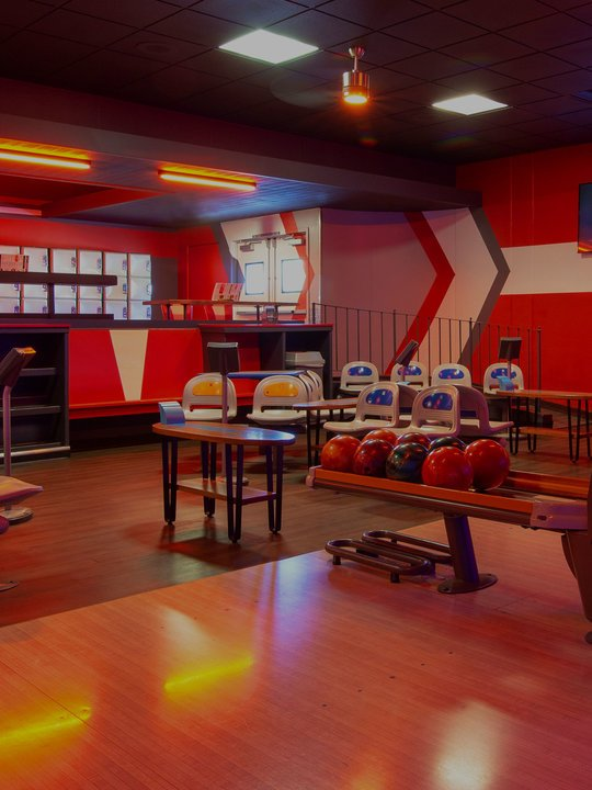 Lanes, seating, and lockers at Bowlero West Covina