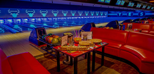 Seating and lanes with food and drinks on table