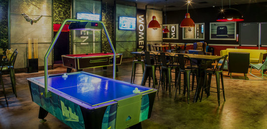 Air hockey, pool table, and dining area