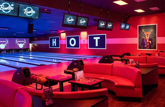 Lanes with plush red couches and black lighting