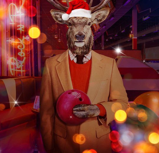 Anthropomorphic elk holding bowling ball in front of bowling lanes