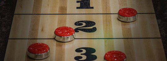 Close up image of a shuffleboard table