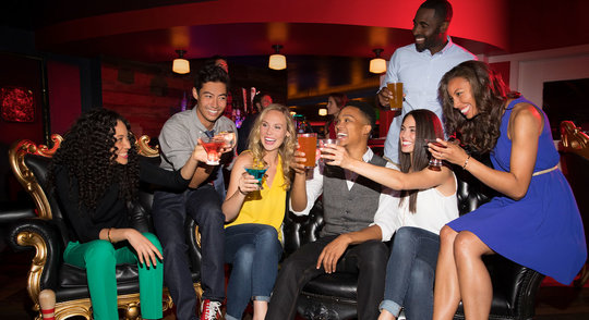 group of friends cheering a drink