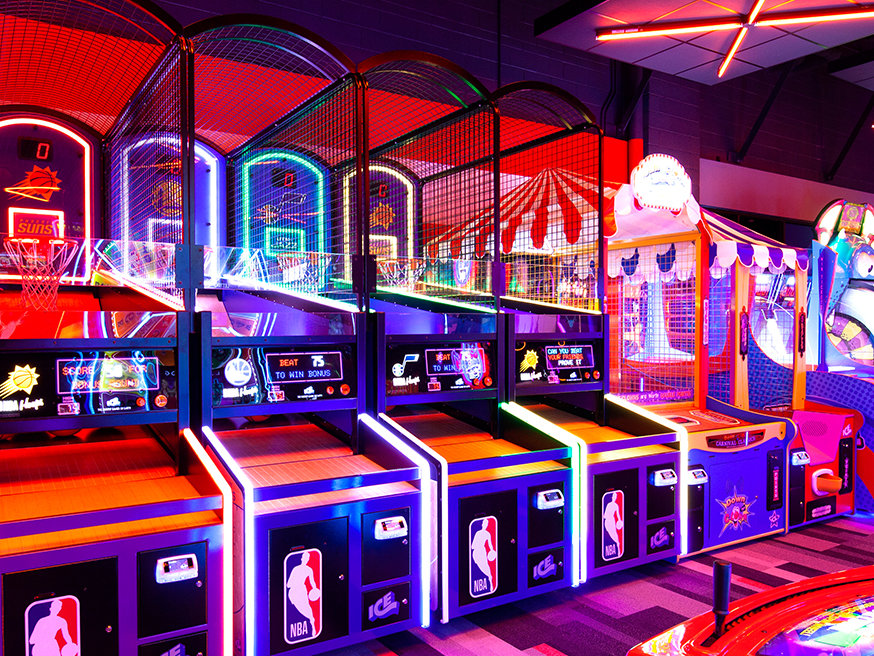 Bright and neon picture of an arcade with a basketball game