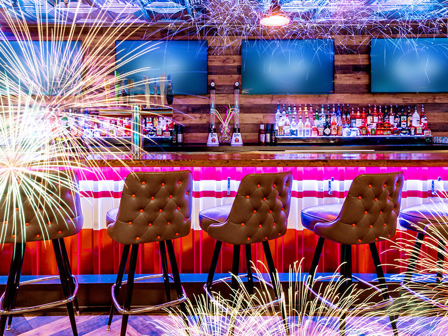 Bar area overlayed with fireworks