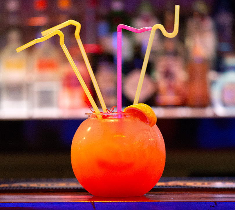 fancy cocktail drink with straws coming out of it