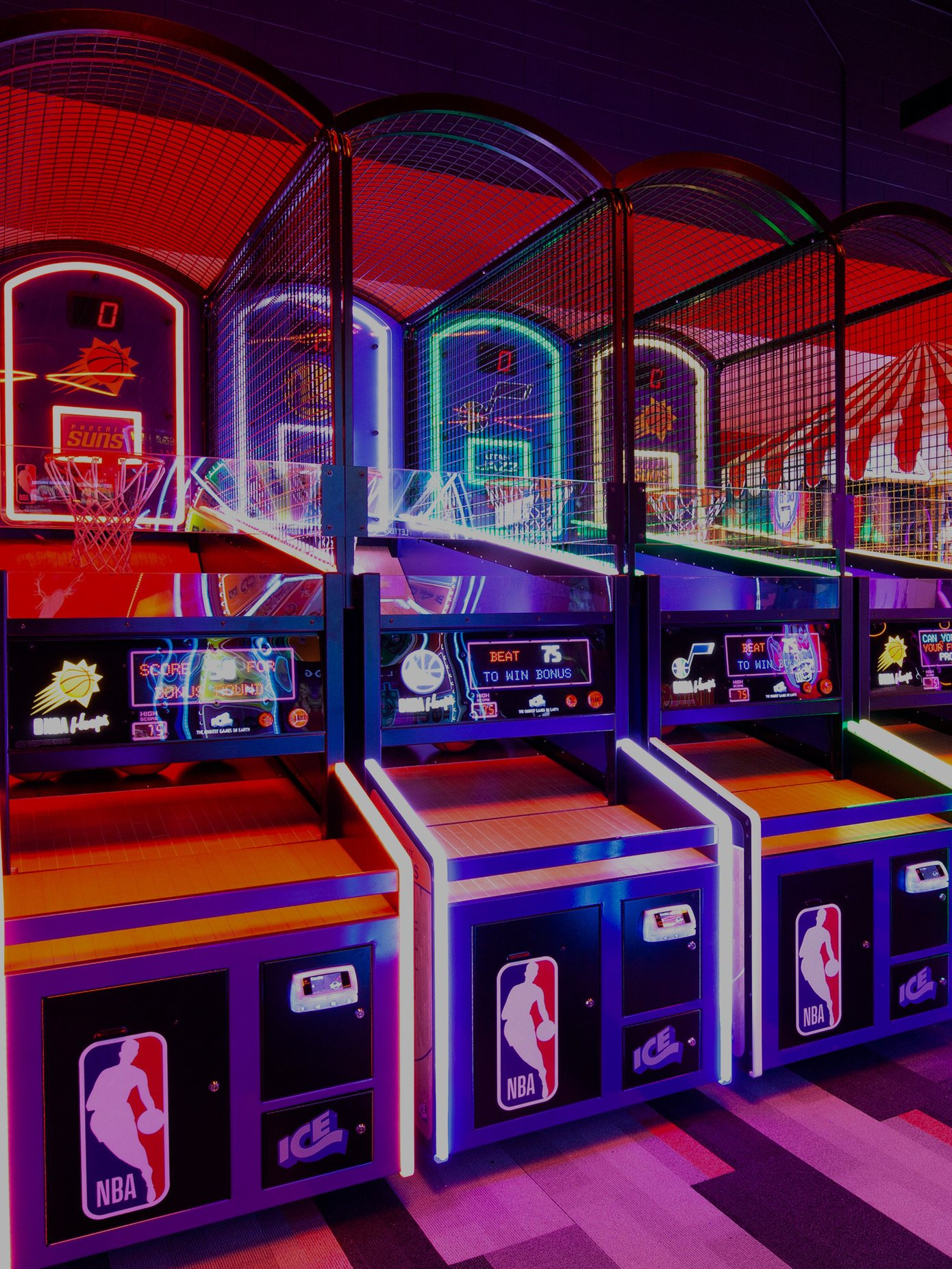 neon lit arcade games in a row