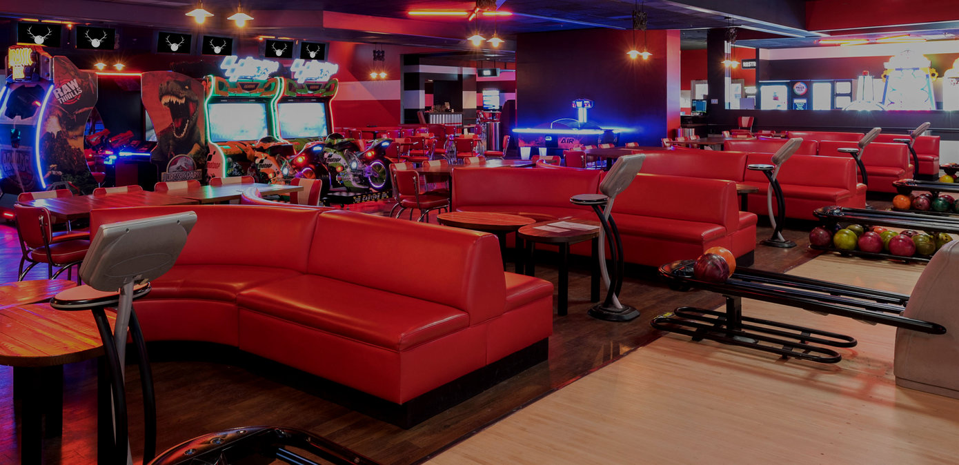Red lounge seating with an arcade in the background