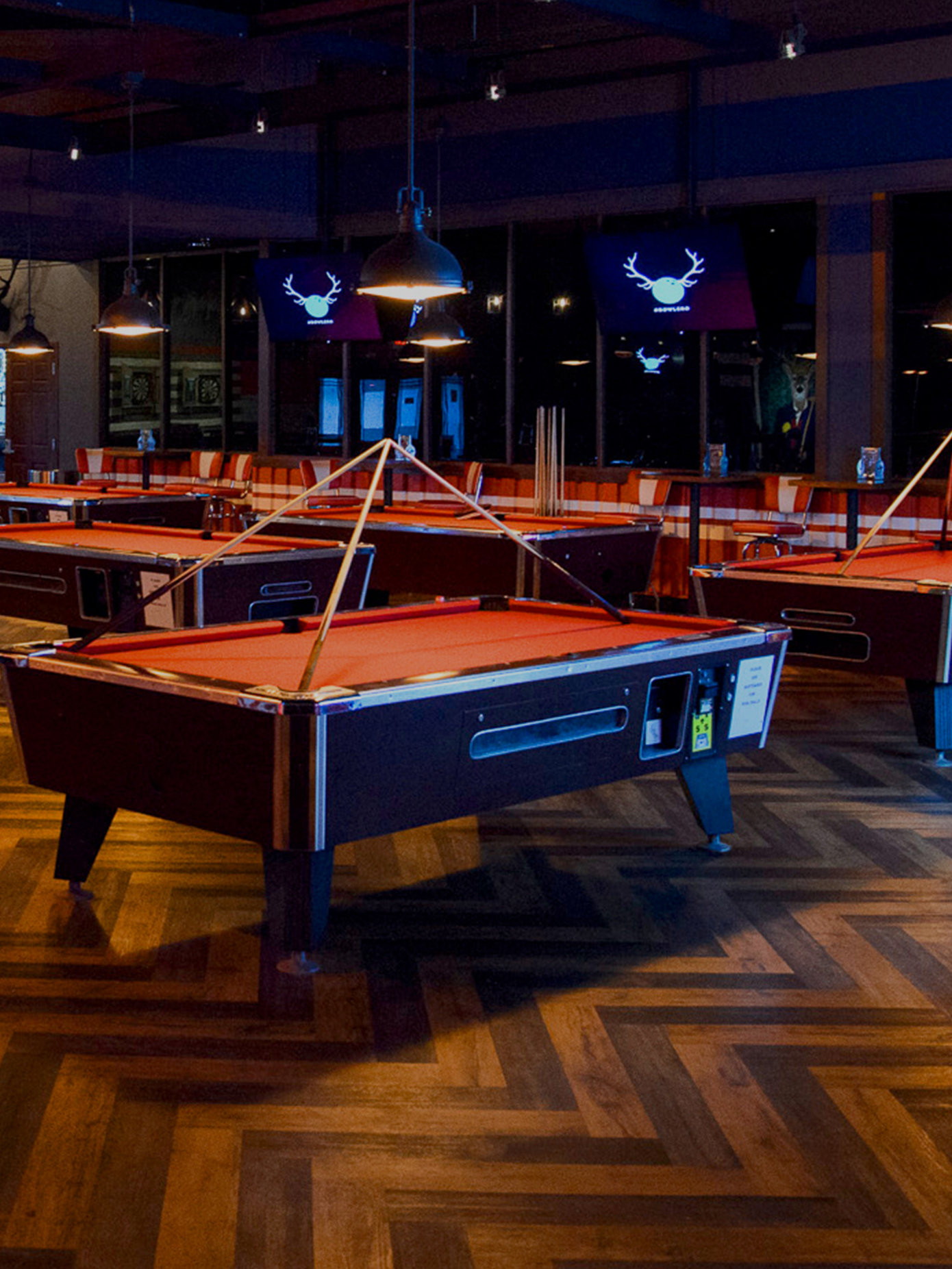 Multiple red billiards tables