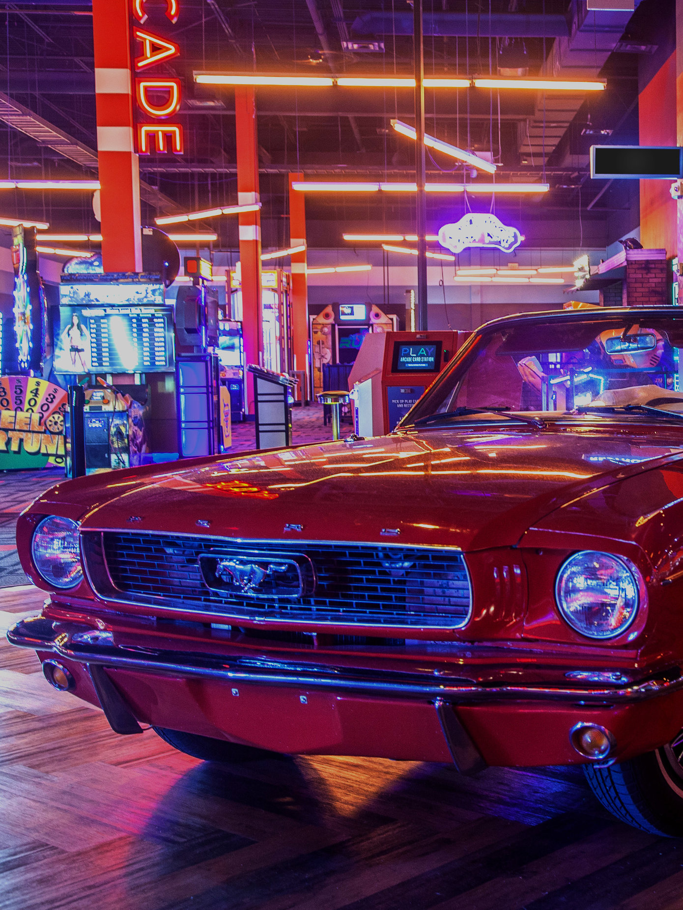 Retro red car with an arcade behind it