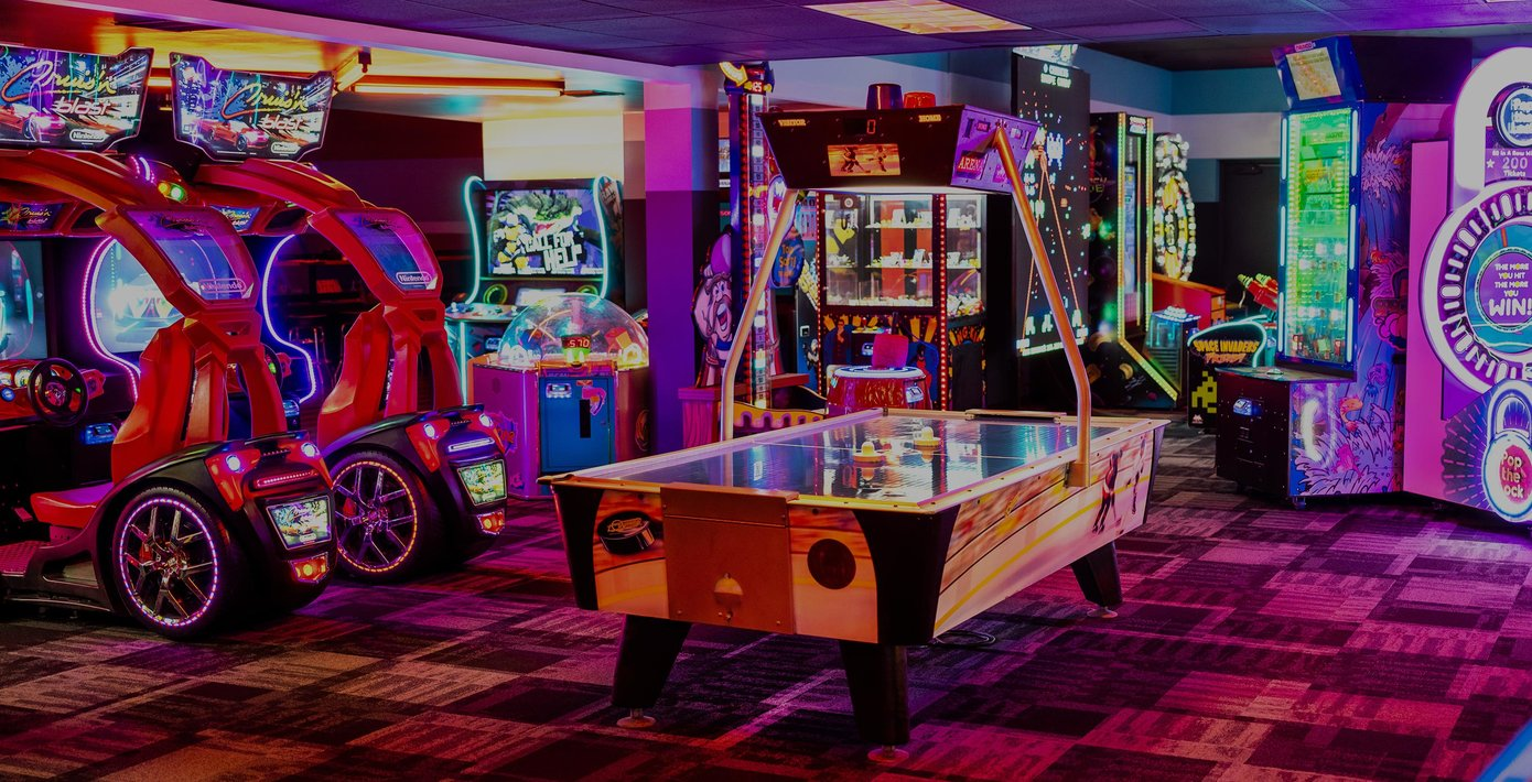 view of arcade and air hockey table
