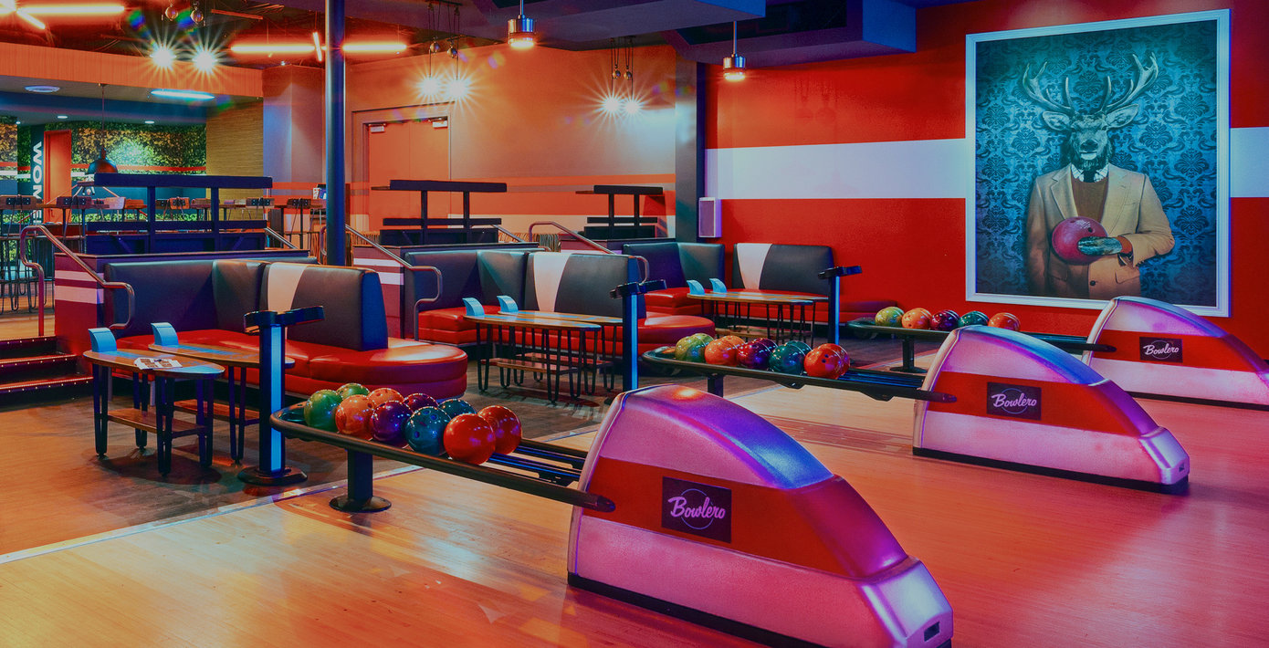image of bowling lanes, ball racks, and booth seats