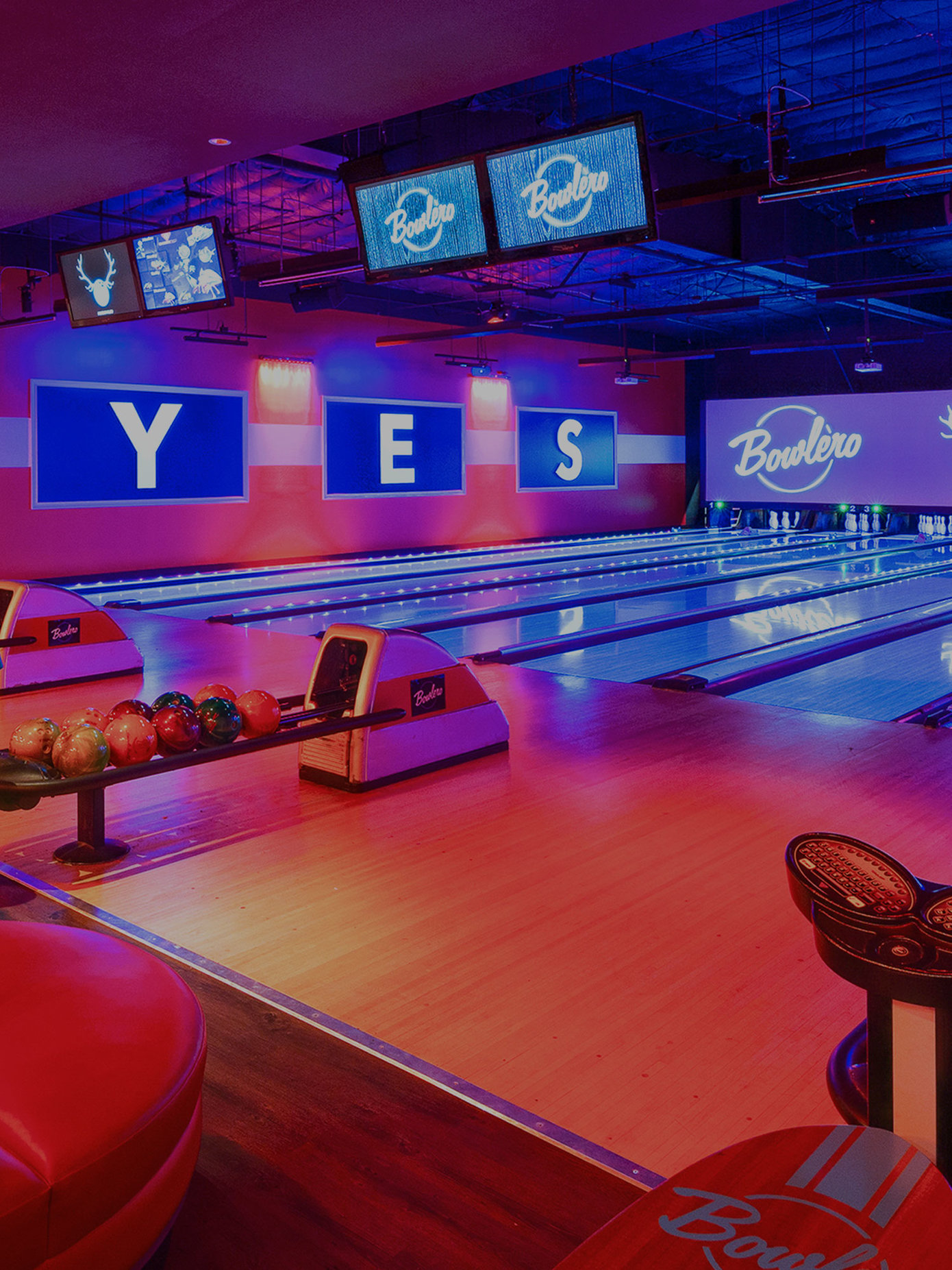 image of bowling lanes facing the pins, with 'y - e - s' written on the wall