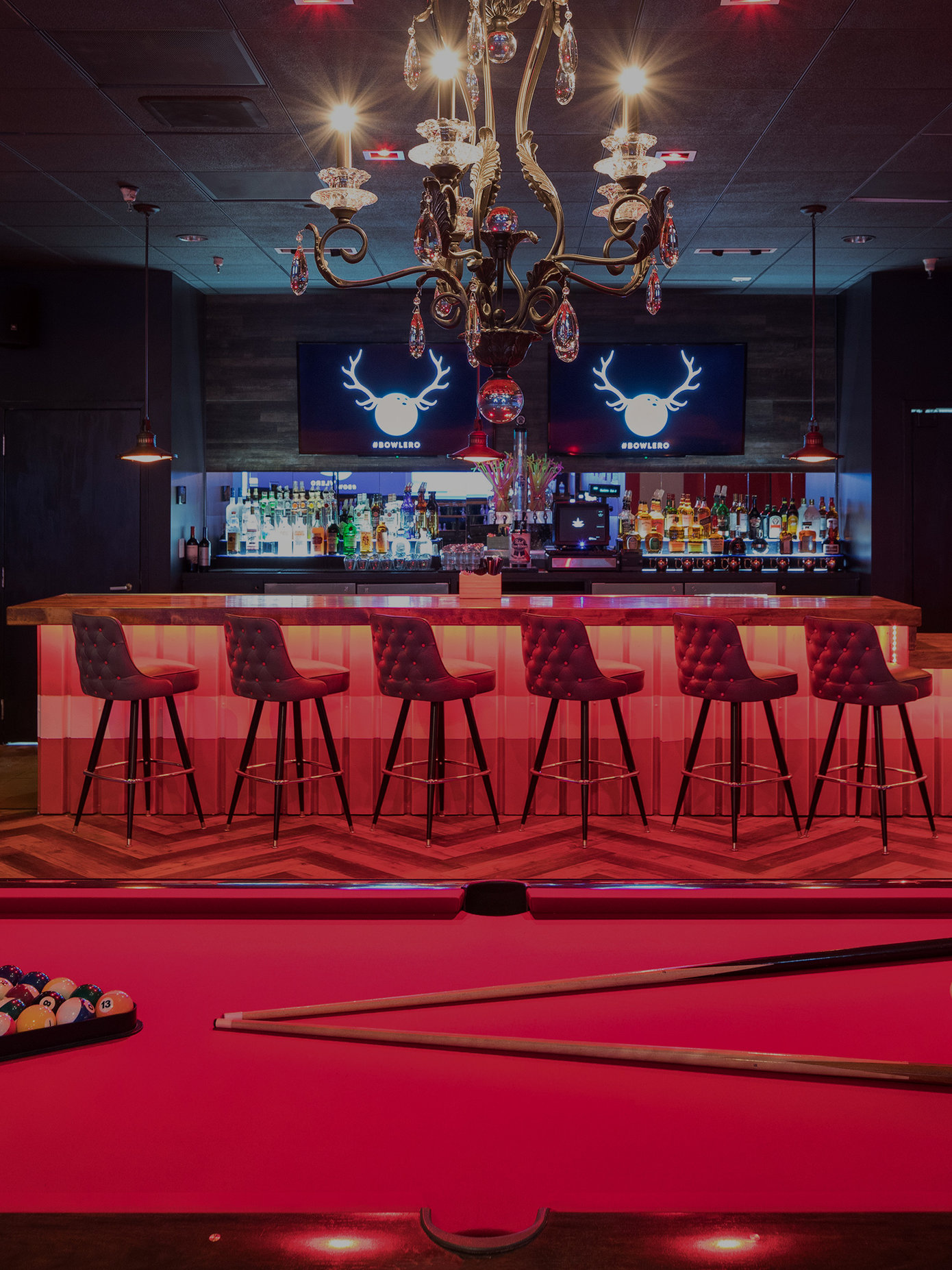 Red billiards tables and a bar