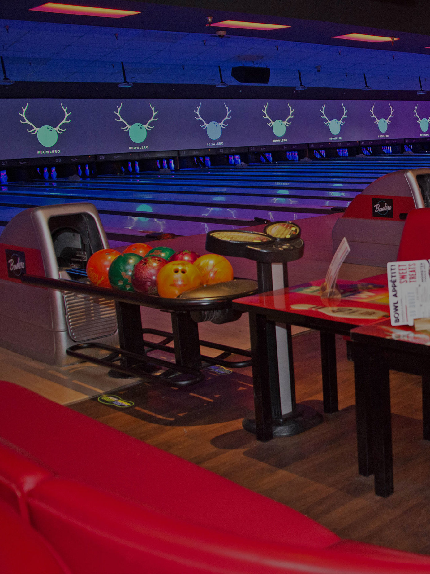 Lanes and seating at Bowlero San Marcos
