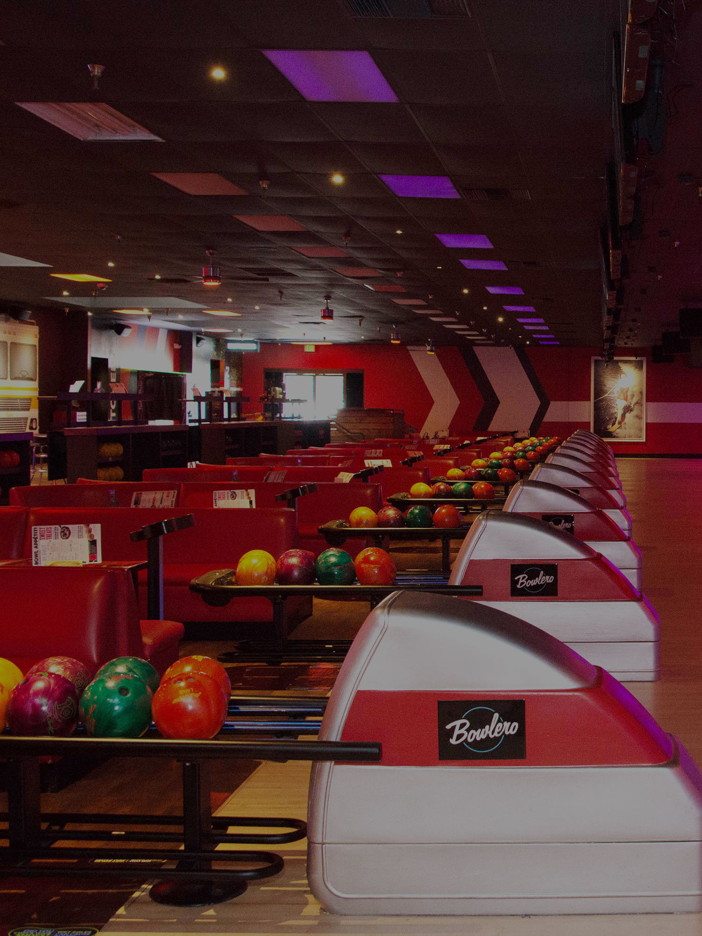 Lanes and ball returns at Bowlero San Marcos