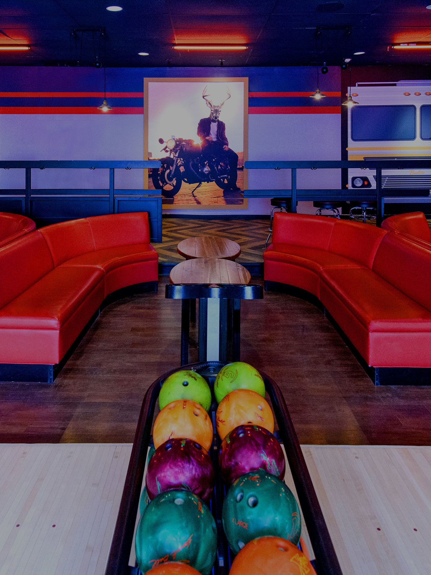 Red plush couches and ball return