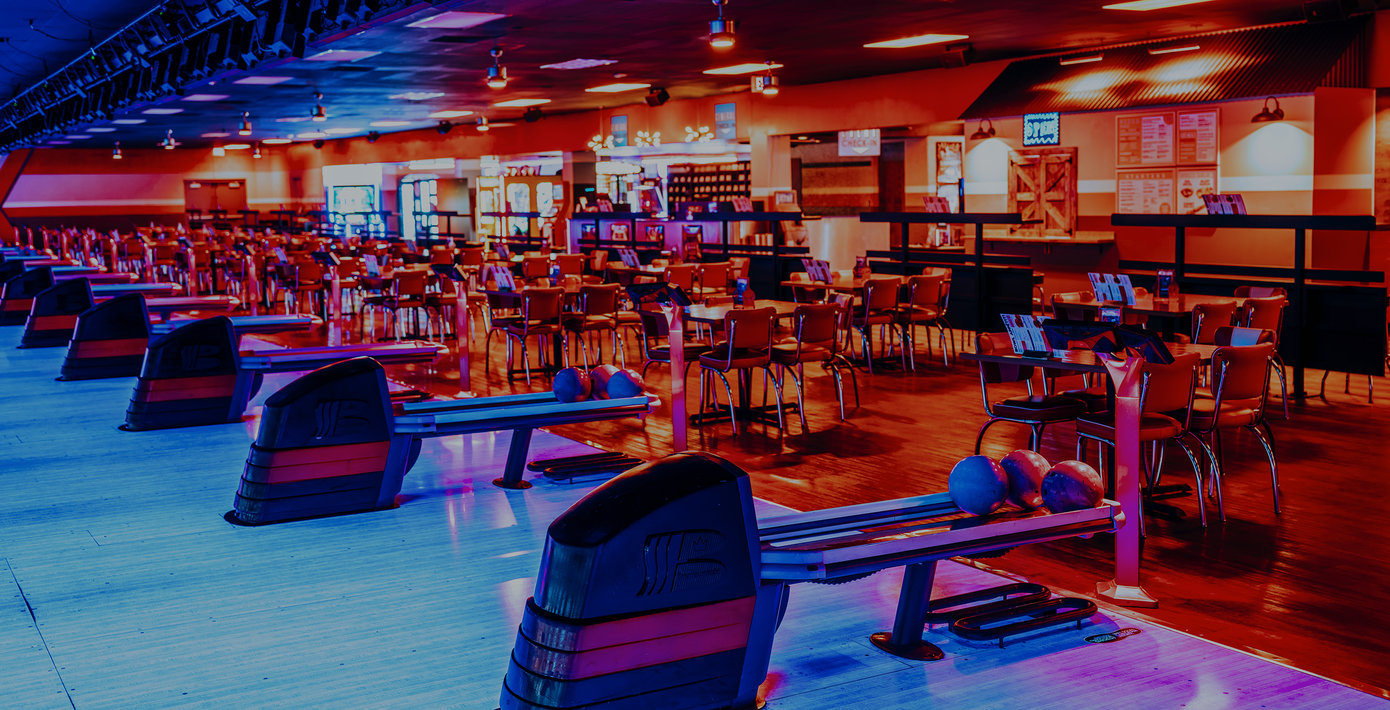 bowling ball racks and seating areas