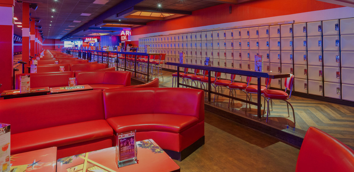 Red plush couches and lockers at Bowlero Visalia