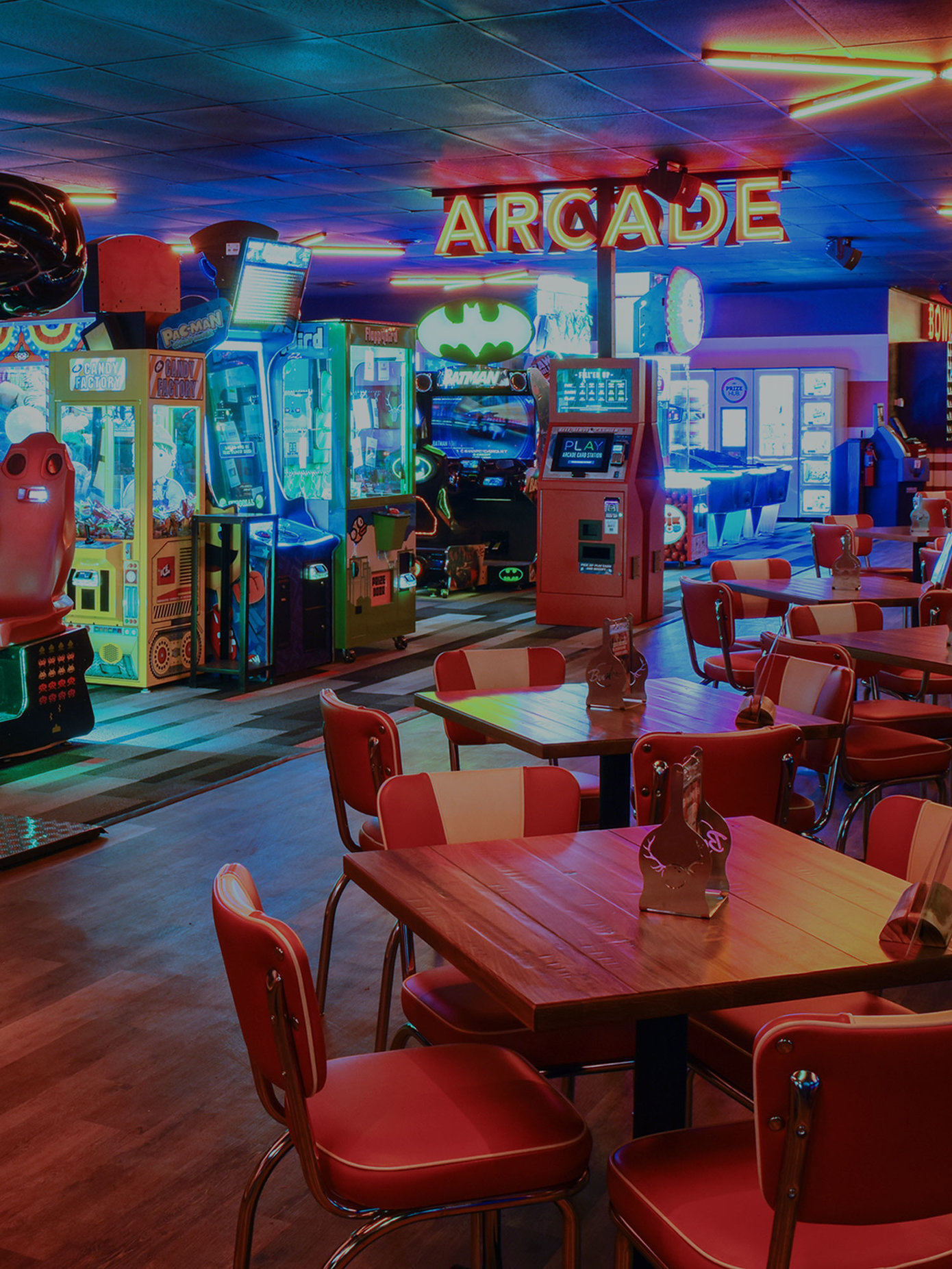 Arcade area and dining tables