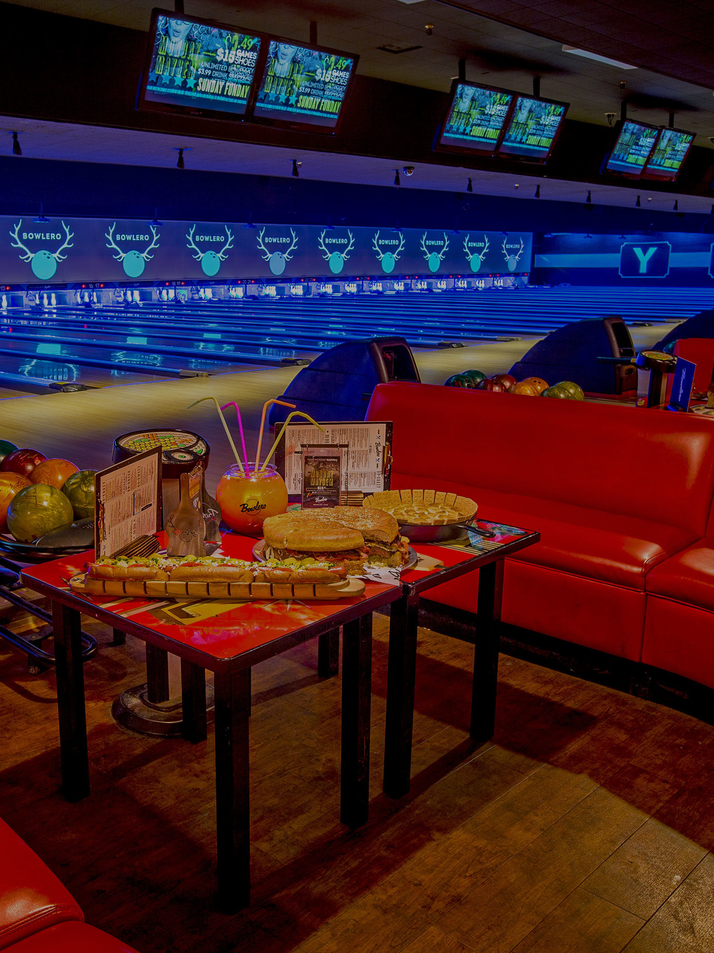 Seating And Lanes With Food Drinks On Table