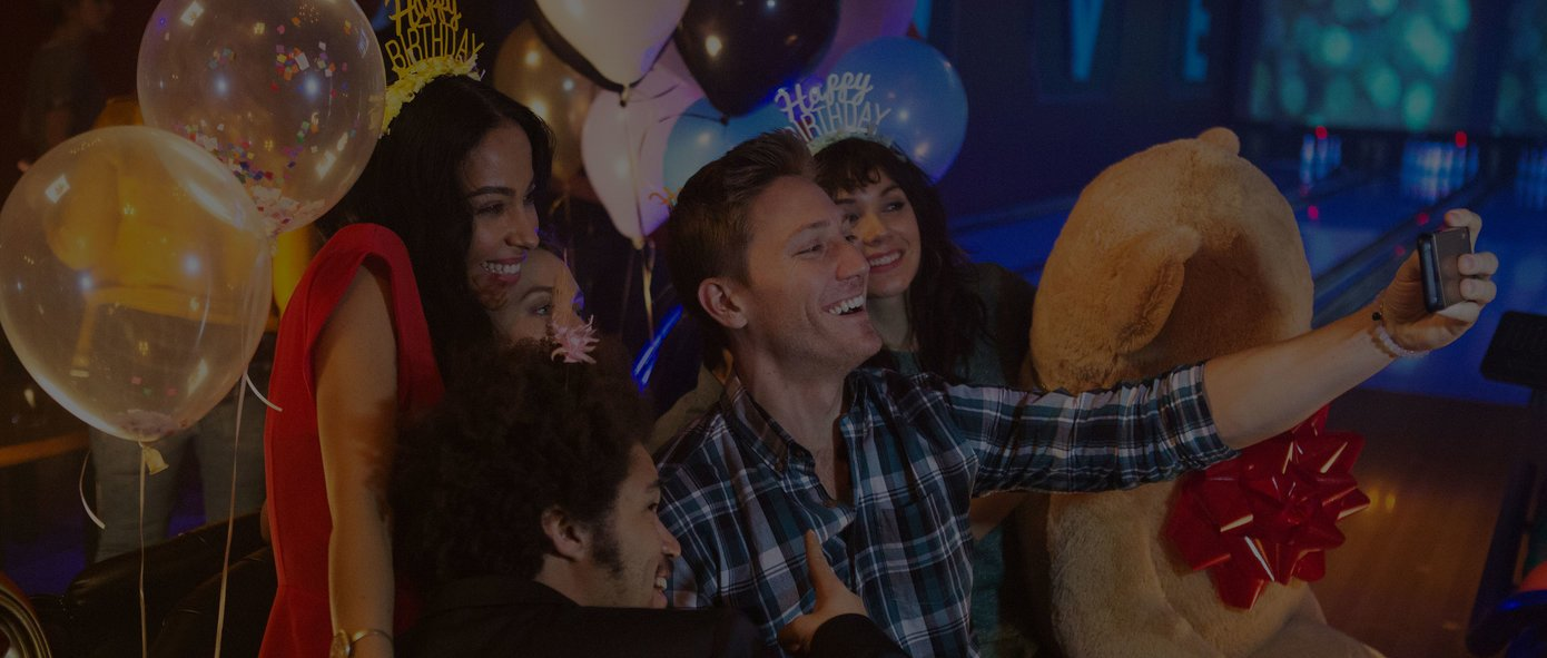 Friends Taking A Selfie On The Lanes At Birthday Party