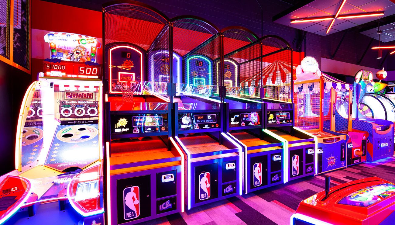Row of Arcade Games Lit in Neon