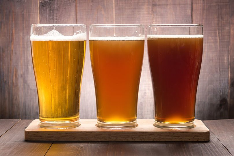 Three pint glasses of beer