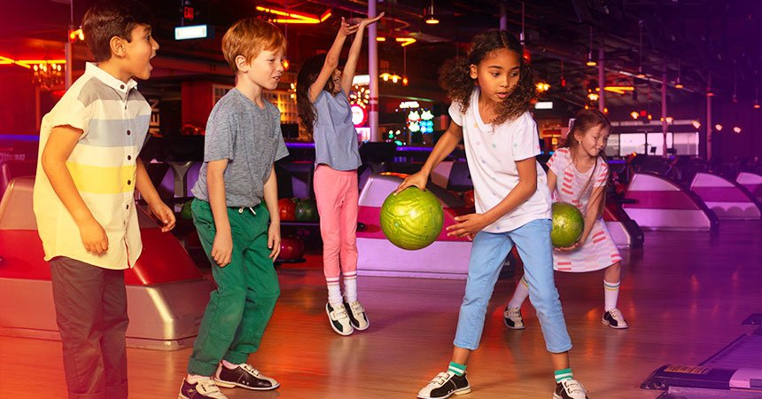 group of kids bowling on the lanes